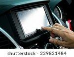 driver entering an address into ... | Shutterstock . vector #229821484