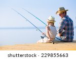 Father And Daughter Fishing On...