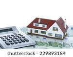 house and money with calculator ... | Shutterstock . vector #229893184