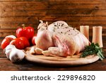 raw chicken on wooden table | Shutterstock . vector #229896820