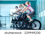 fitness together on bicycles.... | Shutterstock . vector #229949230