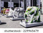 """Small photo of Citygate, Hong Kong, Sept 1, 2014: Exhibition of elephant sculptures;with the title """"Something BIG is afoot at Citygate outlets"""""""