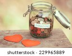 Glass Money Jar With A Label...