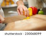 man's hands cutting pepper.... | Shutterstock . vector #230068099
