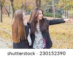 happy pretty girls in the park | Shutterstock . vector #230152390