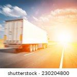 semitruck driving to sunset | Shutterstock . vector #230204800