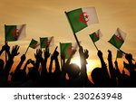 Small photo of Silhouettes of People Holding Flag of Algeria