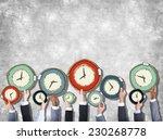 group of hands holding clock | Shutterstock . vector #230268778