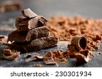 Small photo of Dark chocolate stack, chips and powder
