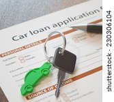 Small photo of Car loan application with car keys and pen