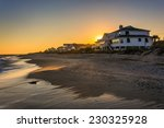 sunset over beachfront homes at ...