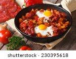 Fried Eggs With Chorizo On...