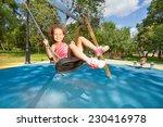 Beautiful Little Girl Swinging...