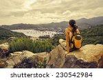 woman traveler looks at the... | Shutterstock . vector #230542984