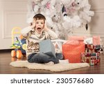 boy with new year presents | Shutterstock . vector #230576680