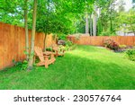 fenced backyard with green lawn ... | Shutterstock . vector #230576764