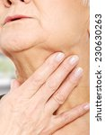 close up on older woman's hand... | Shutterstock . vector #230630263
