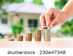 male hand putting money coins... | Shutterstock . vector #230647348