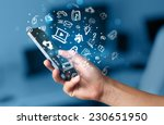 hand holding smartphone with... | Shutterstock . vector #230651950