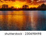 sunset over a lake  in the...   Shutterstock . vector #230698498