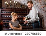 Sommelier Helping Young Woman...