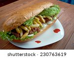 Small photo of Gatsby - South African sandwich.Different varieties of Gatsbys include masala steak, chicken, polony, Vienna sausage, calamari, fish, and chargrilled steak.