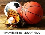 Sports Balls On Wooden...