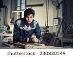 young craftsman in uniform... | Shutterstock . vector #230830549