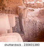 Small photo of Strange carvings and steles in the archaeological site of ancient town of Gobekli Tepe (Pot-belly Hill) in Southeastern Turkey