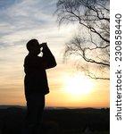 man looking through binoculars... | Shutterstock . vector #230858440