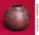 Old Hand Made Wooden Vase On A...