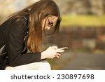pretty girl using mobile phone...   Shutterstock . vector #230897698