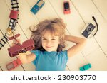 child playing with vintage toys ... | Shutterstock . vector #230903770