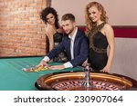 man and women playing roulette... | Shutterstock . vector #230907064