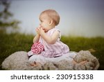 Portrait of a happy small baby girl at a Lake - stock photo