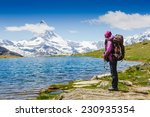 hiker near matterhorn enjoy... | Shutterstock . vector #230935354