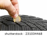man control tire profile with a ... | Shutterstock . vector #231034468
