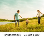 happy family having fun outdoors | Shutterstock . vector #231051109