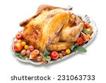 garnished roasted turkey on... | Shutterstock . vector #231063733