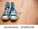 vintage blue sneakers on wooden ... | Shutterstock . vector #231081238