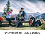 Man And Woman Hikers Hiking An...