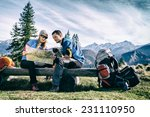 man and woman hikers hiking in... | Shutterstock . vector #231110950