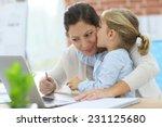 little girl giving kiss to her... | Shutterstock . vector #231125680