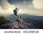 two hikers standing on top of... | Shutterstock . vector #231188518