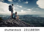 two hikers standing on top of... | Shutterstock . vector #231188584