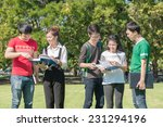happy group of students at the... | Shutterstock . vector #231294196