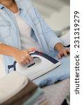 closeup of woman ironing... | Shutterstock . vector #231319279