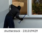 Burglar before burglary into the house, horizontal - stock photo