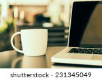 laptop and coffee cup   vintage ... | Shutterstock . vector #231345049