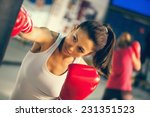 attractive female punching a... | Shutterstock . vector #231351523
